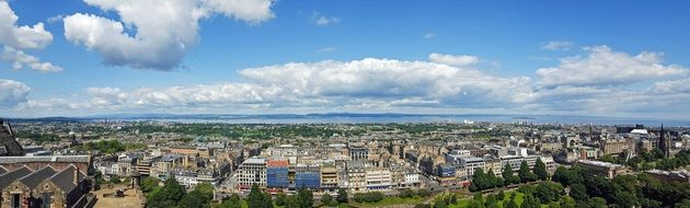 panoramic view of city in front of sea, uk, Scotland, Edinburgh