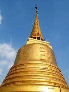 the golden dome of the temple in thailand