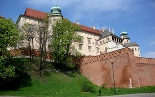 castle on a green hill in krakow