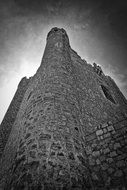 medieval stone tower at sky, bottom view