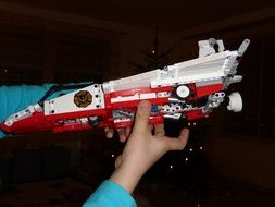 lego weapon in the hand of a child