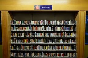 Audio Books on shelves in library