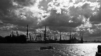black and white photo of a port in hamburg