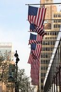 flags of America on the facade of a building in New York