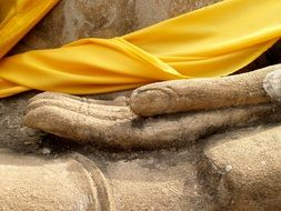 yellow cloth on the statue's arm