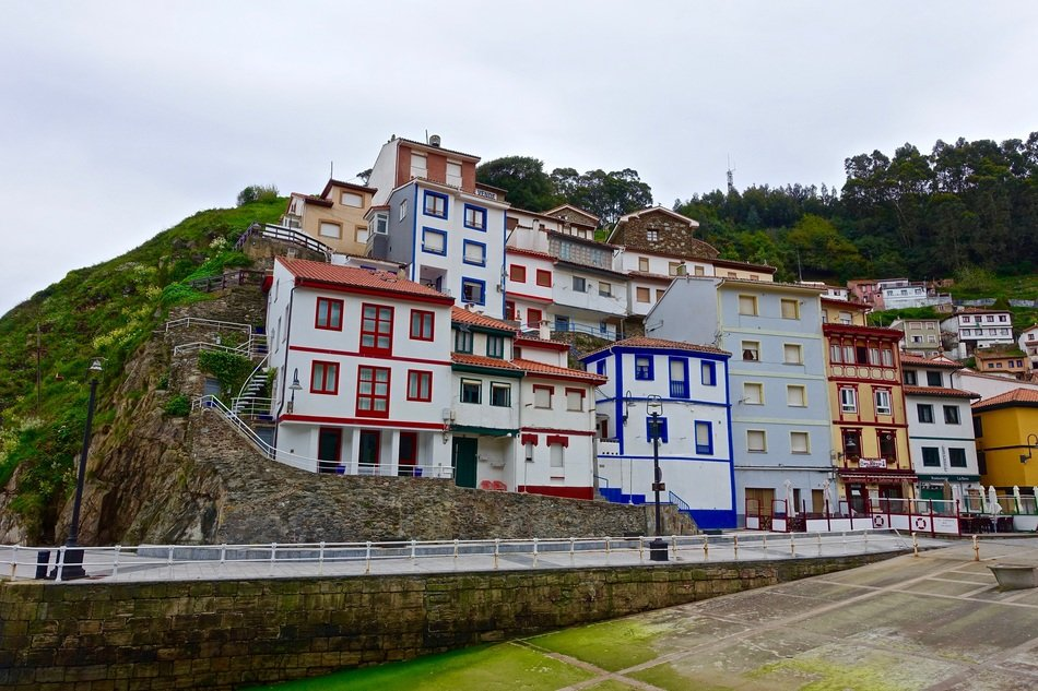 colorful houses in a rock in a seaside village