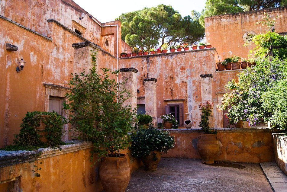 potted plants in courtyard of old building, Greece, Crete