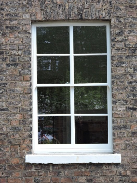 victorian Sliding Sash Window in brick wall