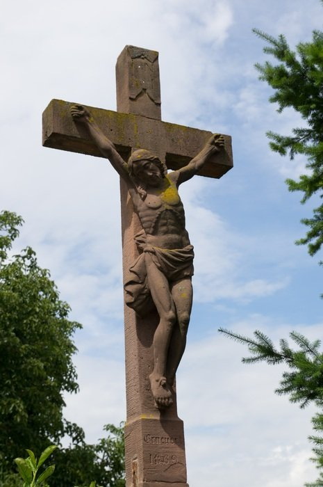 statue of Jesus on a crucifix in Alsace