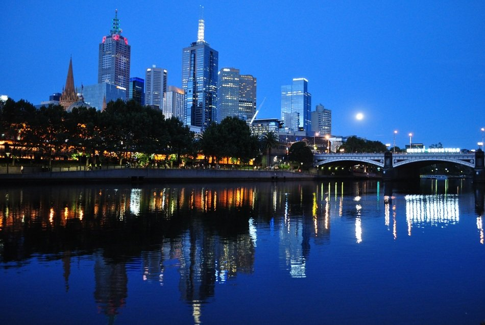 Melbourne architecture reflected in water at dusk