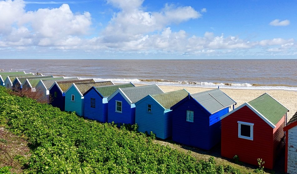 Colorful beach huts on the seaside in England