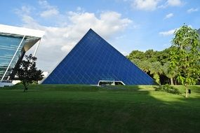 glass pyramid on green grass