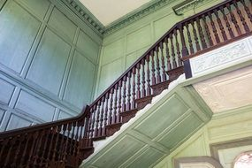 staircase with wooden railing in the mansion