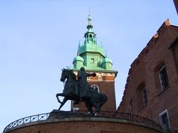 Horse rider monument on the castle in Poland