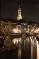Church mirroring on Canal at Night, netherlands, Groningen