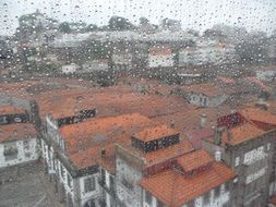panorama of the old city through a wet window in the rain