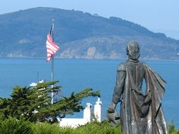 statue of a woman near the american flag