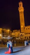 tourists on the square in Siena, Tuscany