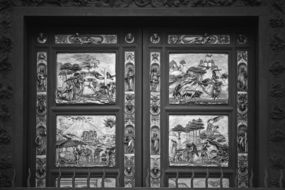 black and white photo of the door with a picture in the temple