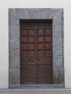 brown wooden door in a stone building