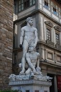 statues of people near the building in italy