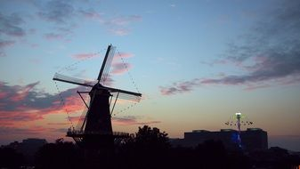 landscape of high windmill at the beautiful sunset