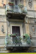 old house Balcony decorated with Flowers, Italy
