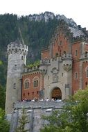 castle neuschwanstein among the trees of bavaria