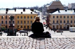 girl looks at the main square of the city