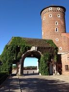 tower near the arched entrance to poland