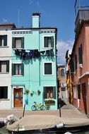 courtyard among colorful houses in the Burano district in Venice