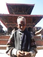 man near a temple in Nepal