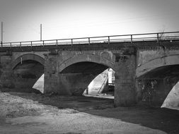 railway bridge in black and white