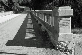 black and white photo of stone bridge in America