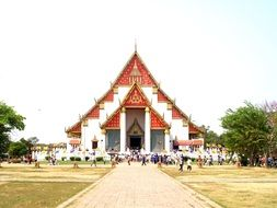 people near buddhist temple in thailand