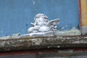 cherub on the facade of the church close-up