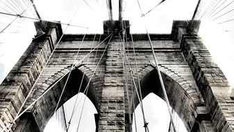 black and white photo of part of the brooklyn bridge
