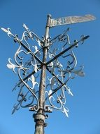 weathervane on a building tower