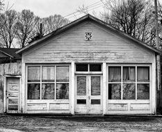 Black and white photo of a wooden shack