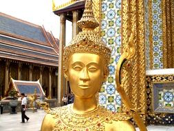 golden buddha statue near the temple in bangkok
