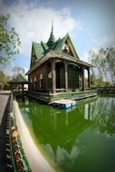 buddhist temple on green water