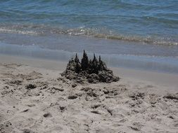 sand castle near the water