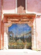 painted on the wooden entrance doors of the building in Roussillon