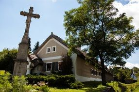 old stone crucifixion at house in summer Countryside landscape, hungary