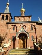 red brick orthodox church in Russia