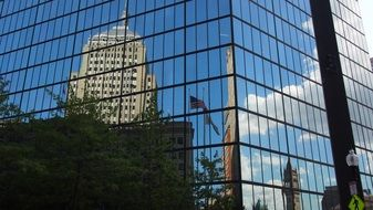 mirror image of a building in a glass facade in boston
