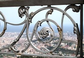 top view of city through wrought iron Fence