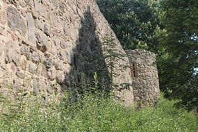urban stone wall near the forest