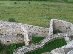 Fortress ruins on meadow, top view, Slovakia