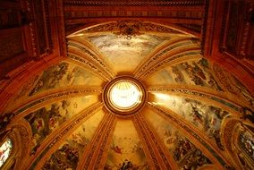 domed ceiling in the church with pictures